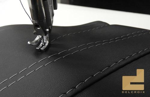 Couture haut de gamme sur un revêtement en cuir